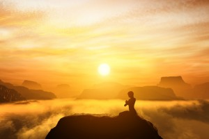 http://www.dreamstime.com/stock-photo-woman-meditating-sitting-yoga-position-top-mountains-above-clouds-sunset-zen-meditation-peace-image43766070