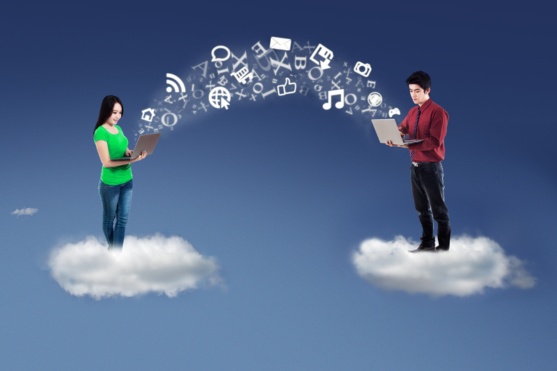 http://www.dreamstime.com/royalty-free-stock-images-young-entrepreneurs-sharing-information-two-business-people-standing-cloud-use-laptop-computer-to-send-image44996939